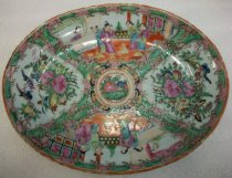 "Image of 2010.092.022 - Holbrook-Palmer Rose Canton Oval Platter, mid-19th century.  Thick stoneware with fine china glaze on top painted in gold, pinks, greens and blues.  Motif has birds and flowers in center and at ends.  Top and bottom motif depicts five Chinese figures--one looking through a window.  ""MADE IN CHINA"" on back in red letters."