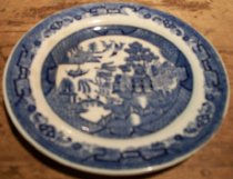 Image of 1999.054.001M - Semi China Tea Plate, c. 1927-1950s.  White with cobalt blue Asian motif of birds, trees, a boat, building, bridge and fence.