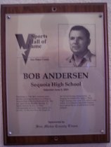 "Image of 2009.030.004 - Plaque commemorating Bob Anderson of Sequoia High School being inducted into the San Mateo County Sports Hall of Fame on June 5, 2001.  Plaque includes image of Anderson and a brief biography:  ""Beginning in 1950, Bob Anderson spent decades coaching just about everything at Sequoia High School in Redwood City. But one sport was his favorite: Boxing. A fighter himself, he won the Fleet Championship as a U.S. Navy man at 147 pounds. At San Jose State, he fought for the NCAA boxing championship. At Sequoia, he nurtured his father's ""Boy's Night"" boxing event until 1976 when it was ended. It is estimated that 4,000 Sequoia boys learned the art of self-defense in that program."""