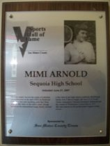 "Image of 2009.030.007 - Wood and acrylic plaque commemorating Mimi Arnold of Sequoia High School who was inducted into the San Mateo County Sports Hall of Fame on June 21, 2007.  Plaque includes image of Arnold and a brief biography:  ""She was simply beyond the realm of suburban comprehension in the mid-1950's in Redwood City. Few had seen anything quite like Mimi Arnold. Her feats on the tennis court, though hailed on the international stage, barely merited a few lines in her high school yearbook. But though barely over 5 feet tall in height, she was a U.S. Lawn Tennis Association National Hardcourt champion and the winner of Wimbledon's Junior title in 1957. She later starred on the professional Virginia Slims circuit."""