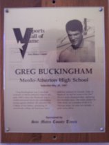"Image of 2009.030.028 - Plaque commemorating Greg Buckingham of Menlo-Atherton High School being inducted into the San Mateo County Sports Hall of Fame on May 22, 1997.  Plaque includes image of  Buckingham and a brief biography:  ""Greg Buckingham was a standout swimmer at Menlo-Atherton High School in the early 1960's when the Peninsula was a world-renowned haven for outstanding young aquatic athletes. He attended the College of San Mateo, producing 10 community college all-American times and four national JC records. Later at Stanford, he led his team to the 1967 NCAA swim championship, capturing two freestyle races. His career peaked in 1968 when, as a member of the U.S. Olympic team, he won two medals, a gold and a silver."""