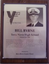 """Image of 2009.030.031 - Wood and acrylic plaque commemorating Bill Byrne of Terra Nova High School who was inducted into the San Mateo County Sports Hall of Fame on June 7, 2000.  Plaque includes image of  Byrne and a brief biography""""Bill Byrne threw his first touchdown pass as a freshman in 1978 at Terra Nova High School in Pacifica. He wound up his prep career by leading the Tigers to an unbeaten season in 1981. He was the North Peninsula League player of the year. Later, at the U.S. Naval Academy, he broke 15 school records, including most completions, most yards passing, and most touchdowns in a single game. When he graduated from the academy, he ranked fifth in career passing. He was sixth in total offense."""""""