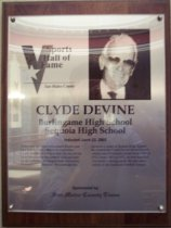 "Image of 2009.030.055 - Wood and acrylic plaque commemorating Clyde Devine of Burlingame High School and Sequoia High School who was inducted into the San Mateo County Sports Hall of Fame on June 23, 2005.  Plaque includes image of Devine and a brief biography:  ""There may not have been a more flamboyant San Mateo County athlete or coach than Clyde Devine. At 6-6 iin height, he was an out-sized presence on the football field and later on the sidelines. At Oregon State University, he excelled as a linemen. He continued his career as a coach at Sequoia High School. He created the Clyde Devine Swim School, which was a Peninsula fixture from 1949 to 1976. From 1963 to 1972, he was Stanford University's diving coach. He also was a referee in the American Football League.""  Plaque and induction was sponsored by The Times of San Mateo."