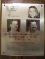 "Image of 2009.030.067 - Wood and acrylic plaque commemorating Jacklyn O'Connor Friedland, Jennifer Horgan Nieto, and Steve Picchi of Burlingame High School who was inducted into the San Mateo County Sports Hall of Fame on June 19, 2008.  Plaque includes images of  Friedland, Nieto and Picchi and a brief biography""As three of the linchpins of Burlingame's 1988 basketball state titlists (the only Central Coast Section public school ever to accomplish that feat), they went on to subsequent productive athletic careers. Friedland became an outstanding three-point shooter in the basketball programs at College of San Mateo and University of the Pacific. Nieto wound up leading UC-Berkeley's 1992 College World Series softball team in home runs and RBI. Picchi has more that 300 wins at the prep and collegiate levels."""