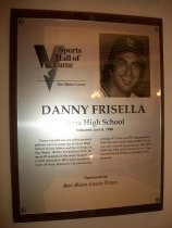 """Image of 2009.030.068 - Wood and acrylic plaque commemorating Danny Frisella of Serra High School who was inducted into the San Mateo County Sports Hall of Fame on June 9, 1999.  Plaque includes image of  Frisella and a brief biography:  """"Danny Frisella was one of the greatest pitchers ever to come out of Serra High School in San Mateo and the College of San Mateo.  Before his death in 1977, he spent 10 seasons in the major leagues as a relief specialist.  His career numbers were: 34 wins, 40 losses; 3.32 earned run average; 57 saves; and 351 apperances.  With the Ney York Mets in 1970-71, he was 16-8 with 83 appearances.  His 1971 ERA was 1.98, with a dozen saves.  The baseball field at Serra is named in his memory.  One of the greatest pitchers out of Serra High School and the College of San Mateo, Danny Frisella went on to the major leagues, playing for teams such as the New York Mets and St Louis Cardinals.  His career was cut short due to his death in a dune buggy accident."""""""