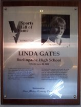 "Image of 2009.030.071 - Wood and acrylic plaque commemorating Linda Gates of Burlingame High School who was inducted into the San Mateo County Sports Hall of Fame on June 22, 2004.  Plaque includes image of Gates and a brief biography:  ""A powerhouse on the tennis court, Linda Gates dominated her sport at the high school level in the late 1970s. At Burlingame High School, she led the Panthers to a pair of Central Coast Section team titles. She added a CCS singles chapionship along the way. At Stanford University, she wound up as the school's No. 1 singles player in her senior year. In 1985, she won NCAA championships in both singles and doubles. She became an All-American in the process. She was a member of the U.S. team in the Pan American Games in 1983."""