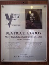 "Image of 2009.030.077 - Wood and acrylic plaque commemorating Beatrice Godoy of Mercy High School and College of San Mateo who was inducted into the San Mateo County Sports Hall of Fame on June 10, 2003.  Plaque includes image of  Godoy and a brief biography:  ""Quick, gritty, and intelligent, Beatrice Godoy was a multi-talented 1990s athlete at both Mercy High School and the College of San Mateo. Basketball and softball were her strengths. At CSM, she was a first team all-state basketball/softball player in her sophomore season, becoming the first San Mateo County female ever to capture both honors concurrently. She matriculated to Pepperdine University where she was one of the best basketball point guards in the West Coast Conference."