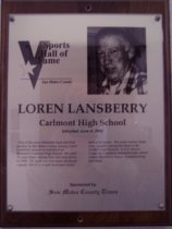 "Image of 2009.030.106 - Plaque commemorating Loren Lansberry of Carlmont High School being inducted into the San Mateo County Sports Hall of Fame on June 4, 2002.  Plaque includes image of Lansberry and a brief biography:  ""One of the most influential track and field coaches in San Mateo County history, Loren Lansberry became an institution at Belmont's Carlmont High School. He spent 32 years there, retiring from full-time duties in 1988. His track and field teams produced a gaudy 304-31-2 overall dual meet record during his tenure. His cross-country teams were annually among the finest in the Central Coast Section. A U.S. Marine Corps vet, Lansberry pioneered high school classes devoted to fitness, mountaineering and dance."""