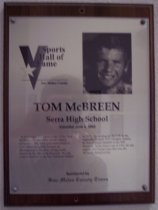 "Image of 2009.030.119 - Plaque commemorating Tom McBreen of Serra High School being inducted into the San Mateo County Sports Hall of Fame on June 4, 2002.  Plaque includes image of McBreen and a brief biography:  ""In his competitive prime in the 1970s, Tom McBreen was one of the world's fastest swimmers. The Serra grad matriculated to USC where he quickly became an all-American in the pool, setting world records in the 400-meter freestyle. He was a silver medalist in the Pan American Games in 1971. Swimming for the U.S. in the tragically ill-fated 1972 Olympic Games, he was a bronze medalist in the 400-freestyle. In his senior year at USC, he was captain of a Trojan team that won the NCAAR championship."""