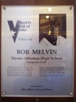 "Image of 2009.030.121 - Wood and acrylic plaque commemorating Bob Melvin of Menlo-Atherton High School who was inducted into the San Mateo County Sports Hall of Fame on June 10, 2003.  Plaque includes image of  Melvin and a brief biography:  ""Baseball is Bob Melvin's life. Ever since he started playing the sport as a kid growing up in San Mateo County in the 1970s, he has been inexorably attracted to it. As a ballplayer, he progressed through Menlo-Atherton High School and various youth leagues. Later, he signed a professional contract and worked his way through the minor leagues to the point where he carved out a 10-year major league career as a backup catcher. Late in 2002, he was named manager of the Seattle Mariners."""