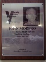 "Image of 2009.030.127 - Wood and acrylic plaque commemorating John Moreno of Terra Nova High School and Skyline College who was inducted into the San Mateo County Sports Hall of Fame on June 23, 2005.  Plaque includes image of  Moreno and a brief biography:  ""Long-distance running was in John Moreno's blood. In both cross-country and track, he is regarded as one of the greatest performers at ever at both Terra Nova High School and Skyline College and later at San Francisco State University. At SF State, he became an all-American in cross-country. A world-class competitor, he qualified to run in three U.S. Olympic Team marathon trials in the 1980's. He won four U.S. marathons during that period. He was named California Distance Runner of the Year in 1985."""