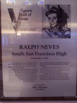 "Image of 2009.030.132 - Wood and acrylic plaque commemorating Ralph Neves of South San Francisco High School. who was inducted into the San Mateo County Sports Hall of Fame on May 16, 1990.  Plaque includes image of  Neves and a brief biography:  ""Jockey Ralph Neves, who was known as the Portuguese Pepperpot, is the only jockey in the history of horse racing who came back from the dead to ride 28 more years.