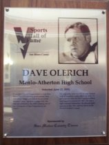 "Image of 2009.030.135 - Wood and acrylic plaque commemorating Dave Olerich of Menlo-Atherton High School who was inducted into the San Mateo County Sports Hall of Fame on June 23, 2005.  Plaque includes image of Olerich and a brief biography:  ""It wouldn't be an exaggeration to state that Dave Olerich's sterling professional football career happened almost by accident. He didn't play big-time college ball. He was not drafted by the NFL coming out of the University of San Francisco in the 1960's. He originally went to USF to play basketball. A longtime rugby player as well, he got a tryout with the San Francisco 49ers and signed a contract in 1967. He was a tight end and linebacker. He played eight seasons in the NFL and won two more in the World football league."""