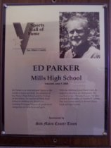 "Image of 2009.030.137 - Wood and acrylic plaque commemorating Ed Parker of Mills High School who was inducted into the San Mateo County Sports Hall of Fame on June 7, 2000.  Plaque includes image of  Parker and a brief biography:  ""Ed Parker is an international figure in the world of track and field. An alumnus of San Mateo High School and the College of San Mateo, he coached at Mills High School in Millbrae for 30 seasons winning 59 league titles in all grade-level categories, for both boys and girls. With the Millbrae Lions Track Club, he helped develop six Olympians. He coached in two Olympic games. He also coached in a number of Goodwill Games, Pan Am Games and U.S.-Soviet Union track and field meets."""