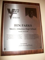 """Image of 2009.030.138 - Wood and acrylic plaque commemorating Ben Parks of Menlo-Atherton High School who was inducted into the San Mateo County Sports Hall of Fame on June 21, 2007.  Plaque includes image of  Parks and a brief biography:  """"When the discussion turns to Ben Parks, the work """"icon"""" comes to mind immediately.  He has been a Peninsula coaching fixture for decades, primarily at Menlo-Atherton High School.  But Coach Parks has been more than that. As a respected and revered community figure, he has been a mentor and teacher for countless young people in the South County area.  As one of his former students put it, """"Coach taught us never to give up on ourselves and always to see how we can be of service to others."""""""