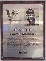 "Image of 2009.030.157 - Wood and acrylic plaque commemorating Dick Roth of Menlo-Atherton High who was inducted into the San Mateo County Sports Hall of Fame on May 16, 1990.  Plaque includes image of  Roth and a brief biography:  ""At Menlo-Atherton High School in the mid-60's, swimmer Dick Roth was known as ""King Richard,"" and he left everyone surging in his wake.  As a senior, he led MA to the national prep swim title.  /  While still at MA, Roth also led the water polo team which lost only one game - a game played while Roth was undertaking another assignment.  /  Roth was in Tokyo as a member of the 1964 United States Olympic swim team.  Despite an attack of appendicitis, the 17-year-old earned an Olympic gold medal in the 400-meter individual medley in world-record time (4:45.4) that wouldn't be touched for another four years.  /  In 1967, as a Stanford University sophomore, Roth won the 200 and 400-meter individual medley races at the NCAA national championship meet, and Stanford came away with the team title.  /  By the time he retired from swimming a year later, he'd won 12 national titles, set seven American records and won the Olympic gold in world-record time."" Plaque and induction was sponsored by The Times of San Mateo."