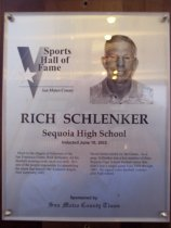 "Image of 2009.030.159 - Wood and acrylic plaque commemorating Rich Schlenker of Sequoia High School who was inducted into the San Mateo County Sports Hall of Fame on June 10, 2003.  Plaque includes image of  Schlenker and a brief biography:  ""Much to the chagrin of followers of the San Francisco Giants, Rich Schlenker did his baseball scouting work much too well. He's one of the people responsible for assembling the talent that brought the Anaheim Angels their surprising 2002 World Series crown vs. the Giants. As a prep, Schlenker was a key member of three Sequoia High School football teams that didn't lose a single game from 1959 through 1961. He signed a pro baseball contract after high school."