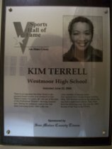 "Image of 2009.030.175 - Wood and acrylic plaque commemorating Kim Terrell of Westmoor High School who was inducted into the San Mateo County Sports Hall of Fame on June 22, 2006.  Plaque includes image of  Terrell and a brief biography:  ""There is no argument that Kim Terrell is the greatest female bowler ever produced in San Mateo County. For years, she was one of the stars of the Professional Women's bowling association. During her collegate days at San Jose State University in the 1980's, she was a key member of Spartan teams that captured four straight league bowling titles. SJS finished second in the nation during Kim's sophomore season. They were third the following year. She was the 1989 Rookie of the Year in the PWBA."""