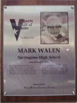 "Image of 2009.030.185 - Wood and acrylic plaque commemorating Mark Walen of Burlingame High School who was inducted into the San Mateo County Sports Hall of Fame on June 23, 2005.  Plaque includes image of  Walen and a brief biography:  ""As a young teenager, Mark Walen didn't cotton much to football. But a high school teacher, who happened to be the varsity football coach, convinced Walen to give the sport a try. It didn't take long for him to be successful. Big and quick for his size, Walen rapidly developed into one of the best lineman on the Peninsula a generation ago. Later, at UCLA, he became the defensive lineman of the year in the Pac-10. He then spent four productive seasons as a defensive tackle with the Dallas Cowboys of the NFL."""