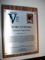 "Image of 2011.026.006 - Plaque commemorating Tori Nyberg of Carlmont High School being inducted into the San Mateo County Sports Hall of Fame on June 14, 2011.  Plaque includes image of Nyberg and a brief biography:  ""Almost from the moment she stepped onto the bucolic Belmont campus of Carlmont High in the 1990's, Tori Nyberg was a pitching phenom.  In four highly successful seasons there, she won a state record 113 games.  She set California marks with 35 wins and 28 shutouts in a single campaign.  She was Central Coast Section Player of the Year and an all-state selection three times.  At Stanford University, she recorded 53 victories, striking out 440 batters in 551 innings.  She had 14 shutouts and a career 1.74 earned run average.  She was an all-Pac 10 performer twice."""