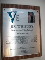 """Image of 2011.026.009 - Plaque commemorating Jim Whitney of Burlingame High School being inducted into the San Mateo County Sports Hall of Fame on June 14, 2011.  Plaque includes image of Whitney and a brief biography:  """"A fearless blocker, rugged defender and slashing runner, Jim Whitney is regarded as one of the best football players ever to wear the red and white at Burlingame, where he was the Peninsula Athletic League Player of the Year in 1948 and an all-Northern California selection as well.  Little did he know that he would become part of college football history at the University of San Francisco three years later.  Whitney was an integral part of a superb Dons' team that went 9-0 but was denied a bowl bid in the South because of the presence of two African-Americans, Ollie Matson and Burl Toler, on its roster."""""""