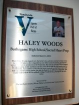 "Image of 2011.026.010 - Plaque commemorating Haley Woods of Burlingame High School and Sacred Heart Prep being inducted into the San Mateo County Sports Hall of Fame on June 14, 2011.  Plaque includes image of Woods and a brief biography:  ""When Haley Woods stepped into the batter's box, pitchers tended to think twice.  As a softball player, she is regarded as one of the most devastating and feared power hitters ever produced on the Peninsula.  She was the scourge of two leagues during her prep career and then tore the cover off the ball for four more years at UC-Berkeley.  As a catcher at Cal, she set career records in total bases (413) and RBI (191).  In her senior season, she led the Bears in 10 offensive categories.  Her teams went to three NCAA softball College World Series, playing for the title twice."""
