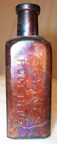 "Image of 2006.254.011 - Root Beer Extract Bottle, c. 1880-1920.  Brown glass square bottle with ""Bryant's Root Beer"" embossed on all four sides. Narrow neck with flared rim which appears to be ground down. this is a root beer extract bottle. Bottle has side mold seams up to but not on the rim. Has a mouth blown rim, which dates prior to 1915. Air venting marks on shoulder. Cup mold bohorn (1880s-1920). Manufactured by Williams Davis Brooks & Co."