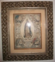"Image of 1993.082.015 - ""Our Lady of Guadalupe"" framed painting of the Virgin Mary.  Female figure is depicted with palms pressed together, a blue robe draped over her shoulders and a crown on her head.  Eleven angels surround the figure and four insets, featuring Mary watching over people, are on each corner of the painting.  The painting is matted under glass, shadow-box style, in a decorative bronze metal frame with a woven pattern."