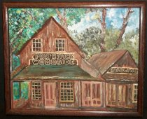 "Image of 1998.055 - 1992 Woodside Store by Rhonda Straub is an acrylic painting on canvass with a brown wooden frame, with no glass. Image depicts a close up of the Woodside Store with signs: ""POST OFFCIE  /  WOODSIDE"" and ""HARDWARE"" above first floor roof line. Sky and treetops can be seen in background. Artist as initialed lower right front corner with orange paint. On back of painting is affixed a San Mateo County Fair participant ribbon that is pink with gold writing and a gold chord (date of fair 11/23/1992)."