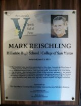 "Image of 2012.009.004 - Mark Reischling Peninsula Sports Hall of Fame Plaque. Plaque commemorating Mark Reischling of Hillsdale High School/ College of San Mateo being inducted into Peninsula Sports Hall of Fame, sponsored by The San Mateo County/ Silicon Valley Convention and Visitors Bureau, on June 13, 2012. Plaque includes image of Reischling and a brief biography:  ""A skilled basketball point guard, he matriculated to Chico State University and later began a coaching career in Gridley and Petaluma. His most significant contributions came as a college basketball referee, however. Over a 42-year period, he made his mark as an official, working more than 1,800 contests, many of them in the important post-season. His resume included 19 NCAA Division 1 conference tournament championship tests, 23 NCAA Division 1 tournament ballgames and the NCAA Final Four. He officiated games in what was then the Pac 10, Mountain West, West Coast, Big West, Western Athletic and Big 12 conferences."" Plaque is wood with an acrylic label attached to front with four screws, one in each corner. Wood has a hole in center top, as well as two grooves on back (one on the left and one on top below the hole), for mounting."