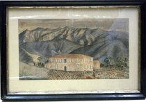 Image of 0001.348 - San Pedro Mission Outpost by A. Chase1865.  Watercolor painting on paper mounted onto ecru-colored mat board under glass inside a black painted wooden frame with a gold-colored inner border.  Image depicts the two-story Sanchez Adobe (established 1785 in Pacifica, CA) when it had an extension out the left side.  Two story building has railing at both levels in front and rectangular windows on both floors.  Building is nestled next to a hillside and foreground is filled with rows of crops, grazing cattle and figures waling on a path leading to the house.  There is a wooden building behind the outpost with a wooden fence between the two.