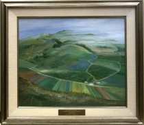 "Image of 1987.042.008 - 1986 Half Moon Bay Commercial Flower Fields by Elizabeth Cassidy.  Acrylic or oil on canvas mounted inside a silver colored wooden frame with a white linen interior mat with a silver colored wooden inner border.  There is an engraved brass plaque mounted to center of bottom linen section of frame which reads, ""FRED GELLERT FOUNDATION  /  COLLECTION OF SAN MATEO COUNTY SCENES  /  ELIZABETH CASSIDY  /  HALF MOON BAY  /  PRESENTED BY ART-RISE  1986.""  Image depicts hillside southern view of farm fields in Half Moon Bay.  There is a grassy field in the foreground and green hills in the background."