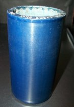 "Image of 2013.036.023 - c. 1912 Edison Blue Amberol Cylinder ""Home Sweet Home the World Over"" by Edison Concert Band is cylindrical in shape with a hollow center, made of celluloid plastic, and is blue in color. The outer edges (1/2"" each end) are smooth, while the center of the cylinder is rough/ridged. The song title is written on one end. This end is perpendicular to the side of the cylinder, while the other end slants upwards slightly. The inside is lined with plaster of paris and is ribbed."