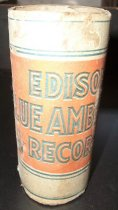 """Image of 2013.036.043 - c. 1912 Edison Blue Amberol Cylinder case is made of cardboard with blue and orange printed paper on the outside. The design has top and bottom bands with solid blue borders and dotted blue interior. The center band has an orange background with blue text (text is just outlined in blue, center of each letter is the orange background) that reads """"EDISON BLUE AMBEROL RECORD"""". On each side of the word """"Record"""" are matching """"Trade Mark  /  Thomas A Edison  /  A PRODUCT OF /  THE EDISON  /  LABORATORIES"""" logos. The back of the cylinder has an image of Edison with the patent numbers and legal text below. Lists price in the U.S. as 60 cents."""