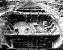 Image of 2013.040.010 - c. 1943 Belair Shipyard Forms Are Being Stripped after Completing Side Shell Pour