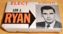 "Image of 2013.041.001 - Elect Leo J. Ryan 1958 Campaign Soap, 1958.  Small travel-size bar of soap wrapped in white paper with a black and white image of Leo J. Ryan and orange and black text that reads, ""ELECT DEMOCRAT  /  LEO J.  /  RYAN"" on the front, ""Cameo Bouquet 'Complexion' Soap"" and ""ELECT RYAN ASSEMBLYMAN"" on the sides and ""CHANGE THE 'COMPLEXION'  /  IN SACRAMENTO  /  ASSEMBLYMAN  /  25th DISTRICT"" on the back.  This unused bar of soap has never been opened."