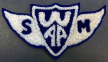 "Image of 2010.176.002J - San Mateo Junior College 'SMWAP' patch, c. 1928-1932.  San Mateo Women's Athletic Program (?) patch in blue and white wool yarn.  Blue shield at center of patch is outlined in white and reads ""W  /  AP"" in white letters.  White wings on either side have a blue letter;  left-side wing has the letter ""S"";  right-side wing has the letter ""M"".  Entire patch is outlined in blue-colored felt.  Secured to cloth backing with adhesive."