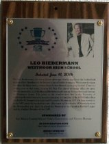 "Image of 2014.019.002 - Leo Biedermann Peninsula Sports Hall of Fame Plaque, 2014. Plaque includes image of Leo Biedermann and a brief biography: ""For Leo Biedermann, size was a distinct advantage. And he used it on the football filed to great effect. Standing 6-8, he became a star offensive lineman at Westmoor during an era when the Rams were a serious factor in San Mateo County prep football. There is a certain irony in the today, because the Daly City school no longer offers the sport. Which means that, in all likelihood, Biedermann will remain the most honored lineman in Westmoor history. His career in the trenches took him to the University of California-Berkeley where he became a standout as a member of the 1975 Golden Bear Co-Pacific 8 Championship team and Honorable Mention in 1977. He then moved on to the NFL where he was drafted in the 12th round by Cleveland in 1978 and played for the Browns that year. Later, he played for Montreal in the Canadian Football League and the Oakland Invaders of the USFL."""