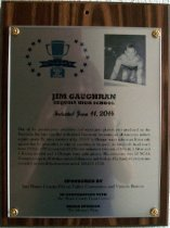 "Image of 2014.019.006 - Jim Gaughran Peninsula Sports Hall of Fame Plaque, 2014. Plaque includes image of Jim Gaughran and a brief biography: ""One of the greatest prep swimmers and water polo players ever produced on the Peninsula, Jim later excelled at Stanford University, becoming an all-American in both aquatic sports. He was a member of the 1956 U.S. Olympic water polo team. It was only natural that he proceeded to take up coaching in the pool. As Standford's head coach from 1960 to 1979 he coached 21 Olympic swimmers (winners of 8 Gold, 2 Silver and 5 Bronze medals) and 4 Olympic water polo players. His swimmers won 22 NCAA Championships in all strokes and all distances, and 4 relays. His Stanford swim teams compiled an overall dual meet record of 129-47-1 (.732)."""