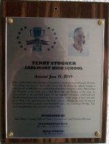 "Image of 2014.019.010 - Terry Stogner Peninsula Sports Hall of Fame Plaque, 2014. Plaque includes image of Terry Stogner and a brief biography: ""Over a professional career in high school athletics which has spanned nearly 50 years, Terry Stogner has become inextricably linked with the Peninsula Athletic League, a collection of 17 public high schools stretching from Daly City in the north to Menlo Park and Woodside in the south and to Half Moon Bay and Pacifica on the coast. As commissioner of the sprawling league, he has upgraded schedules, monitored new playoff arrangements and stimulated fresh interest in a wide range of boy's and girls' sport. Prior to his appointment as the PAL's executive director, he spent 38 years at Carlmont, 36 of them as head varsity basketball coach, with more than 300 wins. The Carlmont gymnasium was named for him in 2003."""