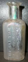 Image of Bottle is stable with abrasion throughout; needs cleaning; The bottle has i