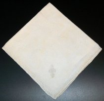"Image of 2010.092.029B - Holbrook-Palmer Napkin, c. 1926-1958.  Cream-colored linen napkin with drawn thread work border in a diamond-shaped pattern.  Stylized ""P"" monogram is satin-stitched in cream-colored thread at bottom right corner."