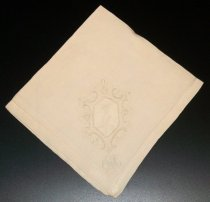 "Image of 2010.092.030D - Holbrook-Palmer Napkin, c. 1926-1958.  Beige-colored hemstitched linen napkin.  Stylized ""OPH"" monogram is satin-stitched in beige-colored thread at bottom right corner.  Directly above monogram is an intricate design of drawn thread work in the shape of a flower, surrounded by satin-stitched embroidery, also in cream-colored thread."