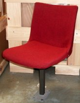 Image of 2013.037.002A - SLAC National Accelerator Laboratory auditorium chair is upholstered in a red wool fabric.  Swiveling chair has a single powder-coated, gray-colored steel leg with a rectangular base that bolts to the floor.  Bracket beneath seat allows it to slide forward and back.