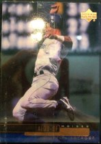 "Image of 2015.003.001 - Moises Alou Baseball Card, 2000, Upper Deck paper card.  The front of the card has an image of Moise Alou jumping, possibly in the act of sliding.  Both his legs are off the ground, his left leg is bent 90 degrees and his right leg is also bent.  His left arm is out to the side and his right arm is above him.  He is wearing a a white Houston Astros uniform with a blue batting helmet, black Nike shoes and a white wrst band on his left arm.  Text in gold reads, ""ALOU - OF MOISES HOUSTON ASTROS"".  The Upper Deck logo is in the top right corner.  The back of the card is blue and lists his biographical information, statistics and accomplishments.  The back also includes Upper Deck, MLB and MLBPA logos as well as copyright information."