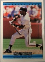 "Image of 2015.003.007 - Kevin Bass Baseball Card, 1991, Donruss paper card with Kevin Bass swinging a bat on the front.  He is wearing a white uniform, with black wristbands and a black batting helmet with orange letters.  Text on blue bar on top reads, ""Donruss 1992"" and on blue bar on bottom reads, ""Kevin Bass Giants Right Field"".  The back of the card has a white background with right, blue, black and white lettering.  The top middle of the back has a headshot of Bass wearing a white jersey and a black batting helmet with an orange interlocking SF.  Text describes his biographical information, accomplishments and lists statistics from 1987 to 1991. Also contains logos for MLB, Donruss and MLBPA as well as copyright information."