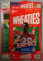 Image of 2015.007.001 - Jerry Rice Collectors Edition Wheaties Box, 1994.  Flattened box without interior bag of cereal.  Front depicts three images of Jerry Rice in his #80 San Francisco 49ers uniform.  Left side has two images of Rice and an image of a white autographed football with information on how to order one.  Right side lists nutrition facts and ingredients.  Back depicts three more images of Rice along with a brief synopsis of Rice's achievements as the all-time NFL touchdown record holder.  Box is orange in color as sections discussing Rice are on a green background.