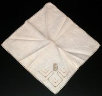 "Image of 2010.092.035A - Holbrook-Palmer Handkerchief, c. 1926-1958. Holbrook-Palmer Collection. Square beige-colored linen handkerchief with light gold-colored hemstitch edge. Geometric light gold-colored and brown-colored satin-stitched  patterns in corner.  Embroidered corner has initials ""OPH"" in rectangular geometric design."