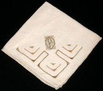 "Image of 2010.092.035B - Holbrook-Palmer Handkerchief, c. 1926-1958. Holbrook-Palmer Collection. Square beige-colored linen handkerchief with light gold-colored hemstitch edge. Geometric light gold-colored and brown-colored satin-stitched  patterns in corner.  Embroidered corner has initials ""OPH"" in rectangular geometric design."