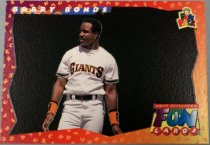 "Image of 2015.003.018 - Barry Bonds Baseball Card, 1994 Upper Deck paper card.  The front of the card has a picture of Barry Bonds wearing a white baseball uniform that reads, ""GIANTS"" across his chest, a black belt and black and orange wrist bands.  He is not wearing a baseball helmet.  The background is dark but when heat is applied shows a cartoon drawing of a stadium with fans, one fan is holding a fishing pole that has caught Barry Bonds' helmet and taken it off.  The border of the card is orange, yellow and purple and reads, ""Fun Cards"" in jumbled letters that repeat.  The front of the card reads, ""BARRY BONDS"", ""Upper Deck Fun Pack"" and ""HEAT ACTIVATED FUN CARDS"".  The back of the card has a black bar along the left side with white text that reads, ""BARRY BONDS"".  There is also an orange, yellow and purple border with orange scrambled text that reads ""FUN CARDS"".  There is a yellow box with black text that describes the story on the front of the card.  The back of the card also contains Upper Deck, MLB and MLBPA logos as well as copyright information."